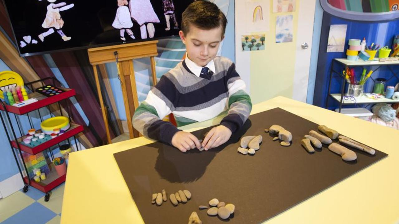 Boy making pictures with rocks