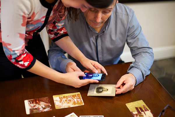 Couple with old photographs