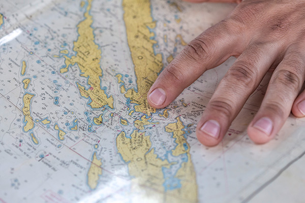 Hand on a map