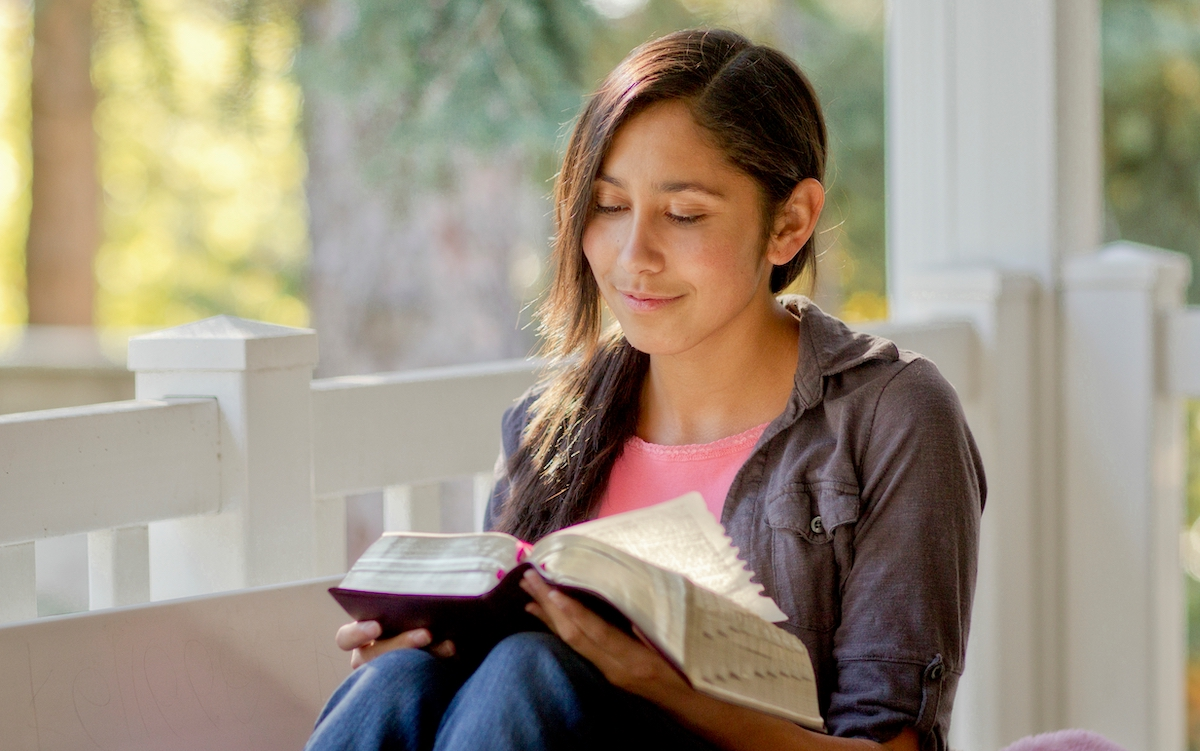 student reads scriptures