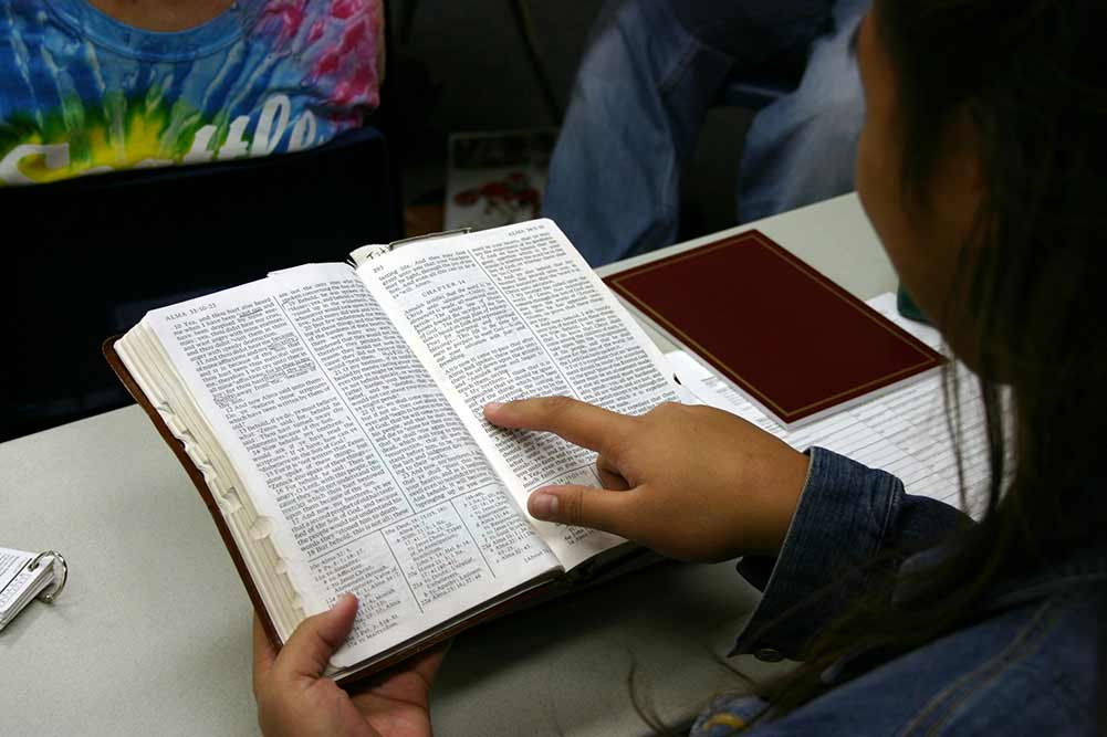 student reading scriptures