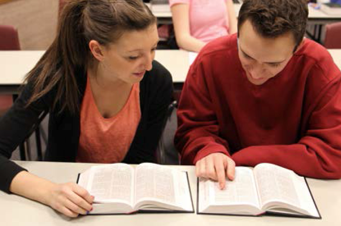 Students reading scriptures