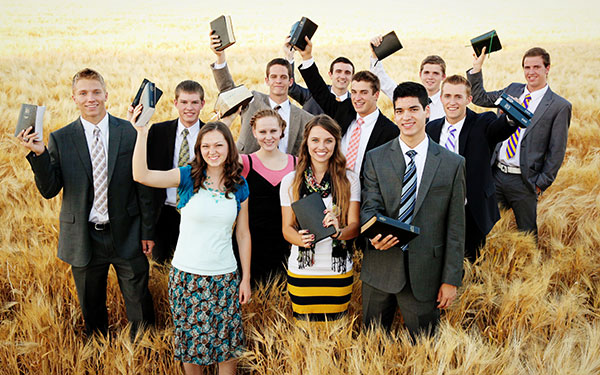 Youth holding scriptures