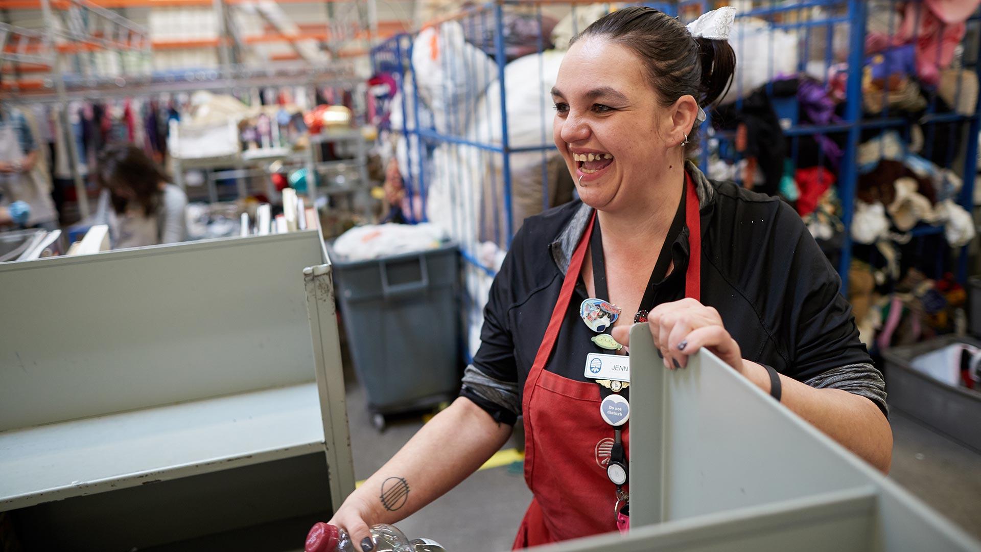 associate Jennifer sorts donations at Deseret Industries