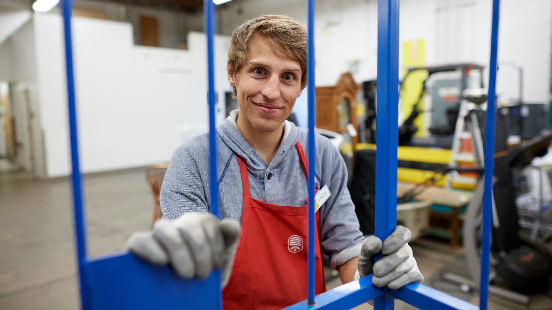 Associate smiling in sorting area
