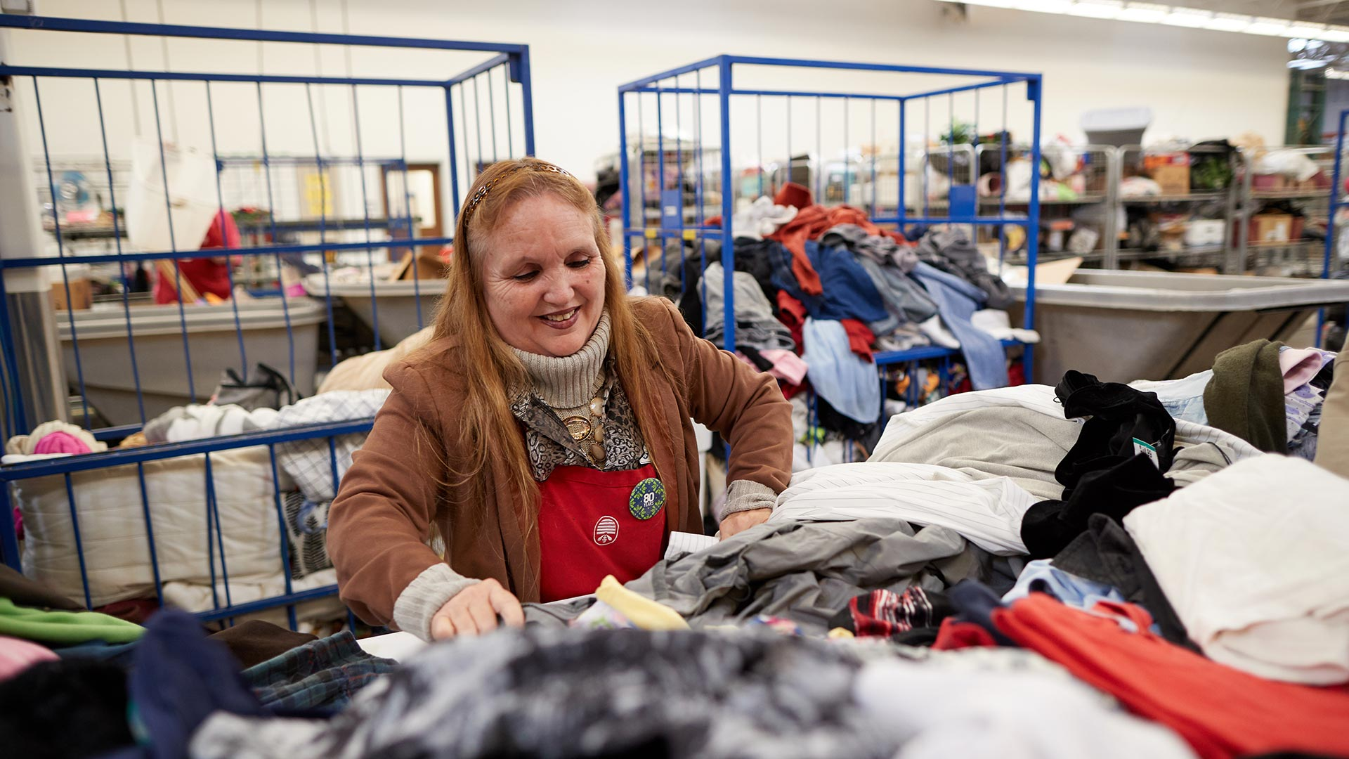 Associate Janice sorts clothes at Deseret Industries