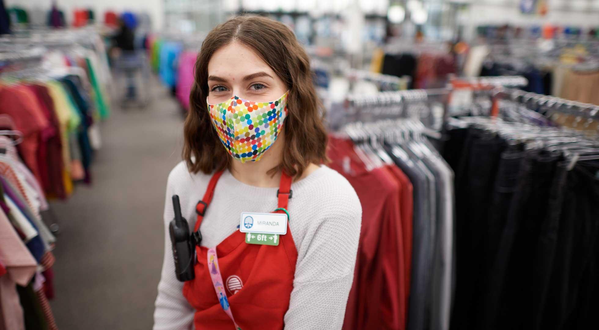 A female associate in a mask.