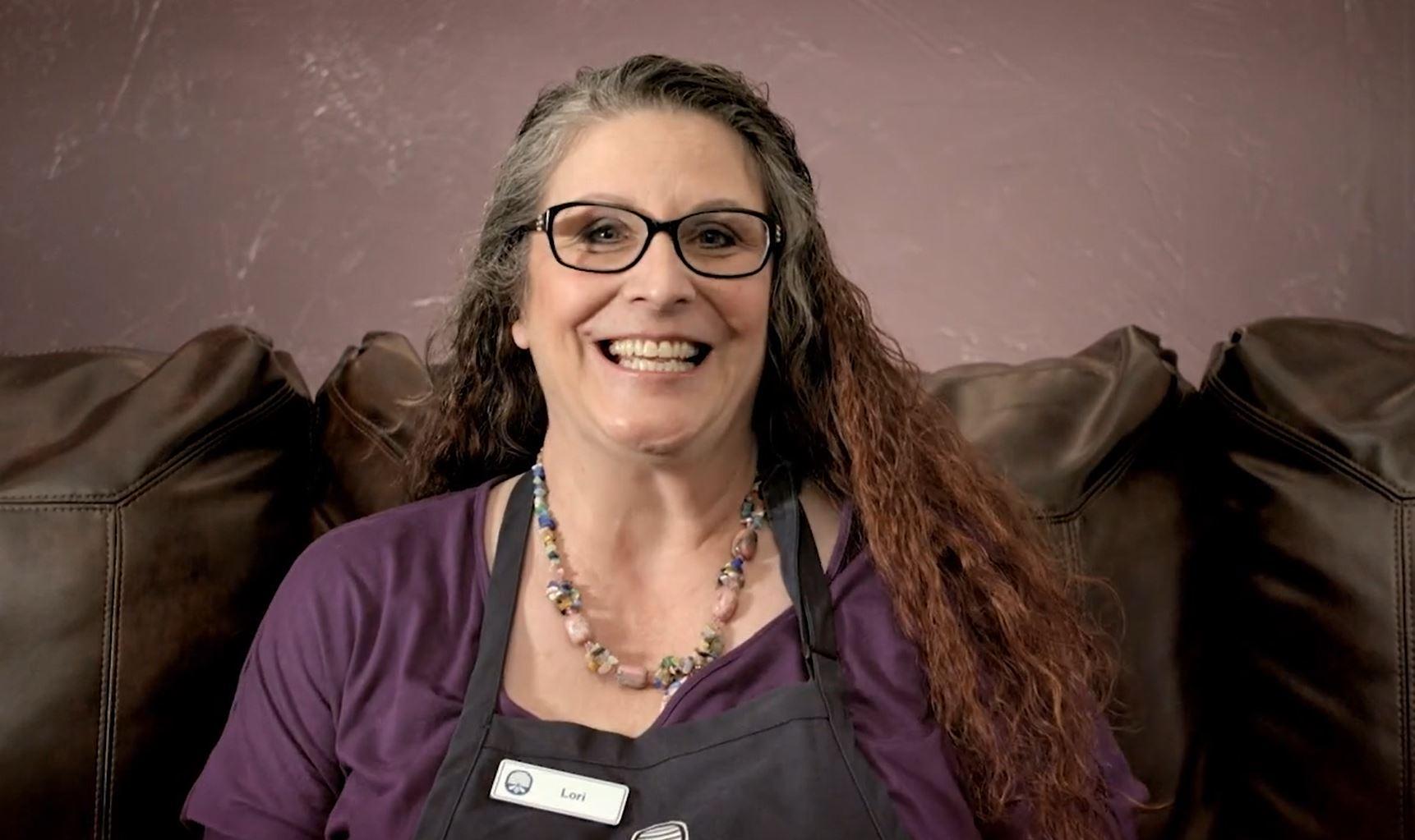 Former associate Lori smiles