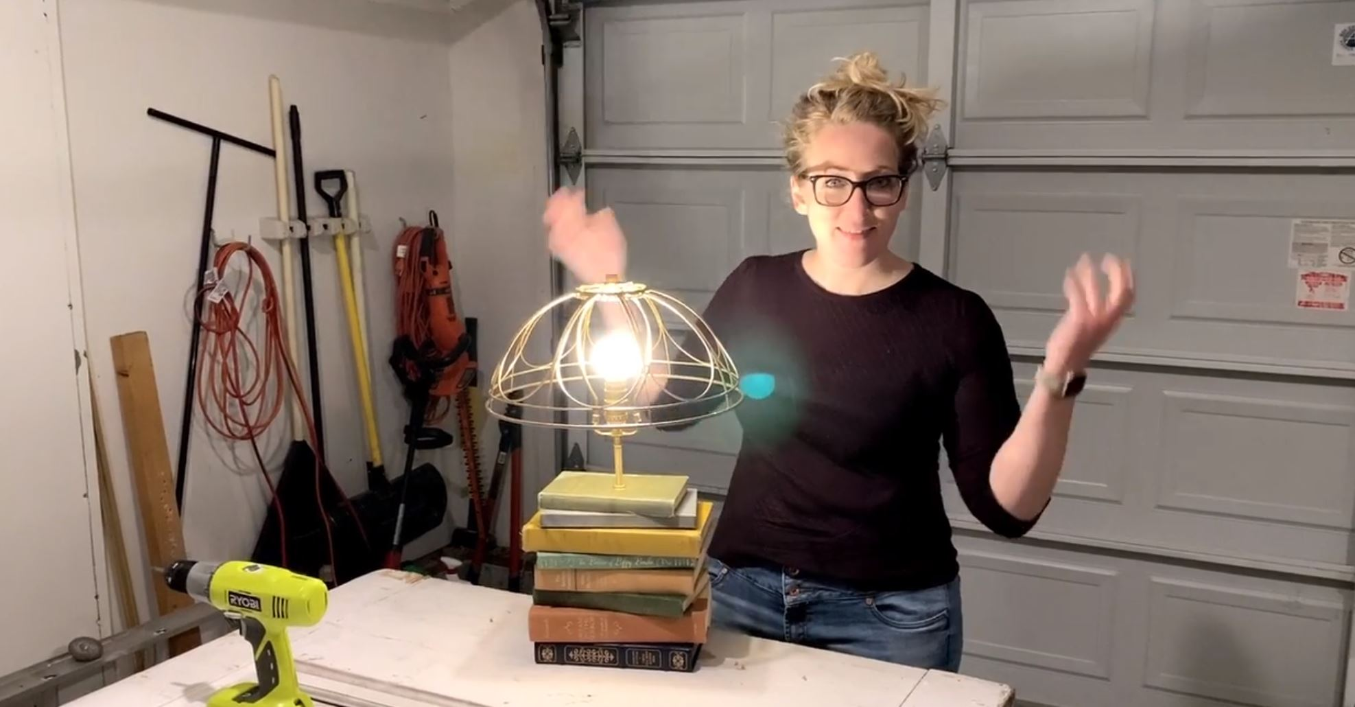 Mallory makes a lamp out of thrifted books.